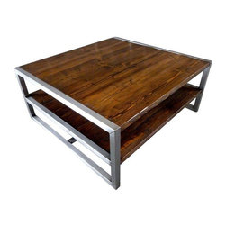 "Used Modern Industrial Two Level Coffee Table - This modern industrial coffee table is entirely handcrafted, and made from recycled lumber salvaged from a Starbucks remodel, and recycled wood from Habitat for Humanity. The wood is treated with espresso stain, and clear coated. This piece offers a perfect balance of natural wood and modern industrial metal.    The seller says: ""I hand weld each metal frame, and then brush finish it before a clear coat is applied. This design offers even more functionality in your home. Recycling wood and metal into stuff like tables and desks is one of the most rewarding aspects of my work."""