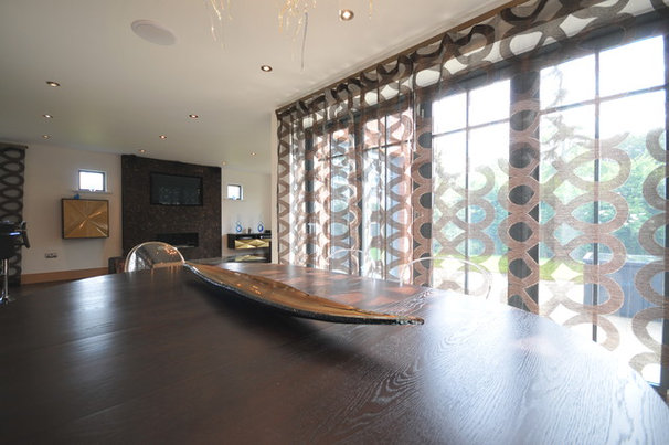 Contemporary Dining Room by Art of Interiors