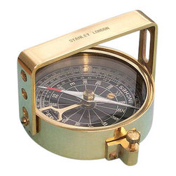 "Clinometer Handle Compass - The Clinometer Handle Compass gets its name from its ""handle"" shaped sight, which actually serves two purposes: With the compass level, an object can be viewed through the peep sights to determine its magnetic heading. The second and most interesting purpose is when tilting the compass on its side and viewing an object through the sights, its angle of elevation or declination can be found. A weighted pendulous arm beneath the compass needle can be read from one of three scales: Angle in degrees beneath the zenith (from straight up), angle in degrees of elevation or declination, and in inches per yard of slope. The ""handle"" sighting arm is stamped ""Stanley London."" The compass has a needle lift mechanism to protect the compass jewel and the pendulous arm when being transported. The compass can fit in a pocket, and measures 2 7/8"" in diameter, 7/8""thick, or 2.25"" tall with the handle up. The compass is crafted from solid brass and polished to a beautiful high luster, and weighs 8 ounces."