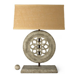Agrass Stone Lamp - A metal rod atop a low stone plinth suspends this object d'art  reminiscent of an Italian rose window made of coarse stone. Adding a touch of architectural romance to any room in your home the Agrass Stone Lamp's buff colored finish will contrast beautifully with any medium or dark wood case good or extend the monochromatic theme of a peaceful retreat.