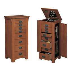 "Powell - Powell Mission Oak Jewelry Armoire - Free-standing ""Mission Oak"" finish armoire with ""Mission Gray"" hardware provides the ultimate storage for all of your jewelry and accessories. Store your rings, earrings and more in the eight black fully lined drawers. Flip-top mirror opens to a black lined compartment. Touch latch side doors swing open to store chains. Minimal assembly, attach top only."