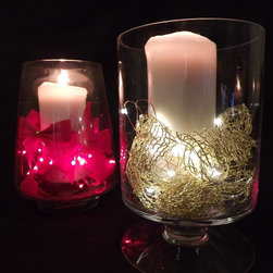 Battery-powered LED Fairy Lights - Use these delicate LED fairy lights to create beautiful centerpiece designs for the holidays, weddings or other special events. Each light set includes a battery pack that is easy to hide. Available in red, white and green at EnvironmentalLights.com.