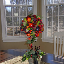 Fun with Floral Design and Boutique items - This topiary was the first of accessories for my client's beautiful new kitchen.  The camel walls and sage greens in window treatments worked well with this fruit topiary with bird.  Pomegranates, figs, berries and ivy are great for transitioning from fall into holiday season.  The vibrant orange gives a great pop of color!  Design by Lauran Corson