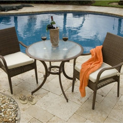 Hospitality Rattan - Hospitality Rattan Grenada 3 Piece Patio Dining Bistro Set - Viro Fiber Antique - Shop for Tables and Chairs Sets from Hayneedle.com! It's easy to set a sophisticated tone in the backyard - just unpack the Hospitality Rattan Grenada 3 Piece Patio Dining Bistro Set - Viro Fiber Antique Brown and place it anywhere on the patio or in the garden. The Grenada Collection has a modern tropical feel that offers a clean look for any patio area - not to mention the convenience of all-weather wicker. This set's two armchairs are each supported by an aluminum frame wrapped in high quality antique brown Viro fiber. High backs offer supreme comfort and decorative open weaving along the sides of each seat is light and airy. The dark bronze aluminum table boasts dramatically curved legs an artful center support and a clear tempered glass top.DimensionsChairs: 24L x 29W x 36H inchesTable: 36 diam. x 29H inchesAbout Hospitality Rattan Hospitality Rattan has been a leading manufacturer and distributor of contract quality rattan wicker and bamboo furnishings since 2000. The company's product lines have become dominant in the Casual Rattan Wicker and Outdoor Markets because of their quality construction variety and attractive design. Designed for buyers who appreciate upscale furniture with a tropical feel Hospitality Rattan offers a range of indoor and outdoor collections featuring all-aluminum frames woven with Viro or Rehau synthetic wicker fiber that will not fade or crack when subjected to the elements. Hospitality Rattan furniture is manufactured to hospitality specifications and quality standards which exceed the standards for residential use. Hospitality Rattan's Environmental Commitment Hospitality Rattan is continually looking for ways to limit their impact on the environment and is always trying to use the most environmentally friendly manufacturing techniques and materials possible. The company manufactures the highest quality furniture following sound a
