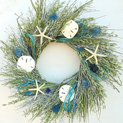 "Frontgate - Sea Glass Wreath - 29"" dia. - Frontgate exclusive design. Made with real white quail brush, oats, Sea Glass, sand dollars and starfish. Use indoors or in a covered outdoor area; oats will fade from sunlight. Choose from two sizes; design changes slightly according to size. Coordinates with our Sea Glass Hurricane Surround. Conjuring the natural romance of the ocean, our Sea Glass Wreath displays the treasures of seaside scavenger hunts. A medley of white quail brush and oats creates a windswept base for sand dollars, starfish and pieces of lapis-hued Sea Glass.  .  .  .  .  . Made in USA."