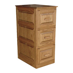 Chelsea Home Furniture - Chelsea Home Bergen 3-Drawer File Cabinet in Red Oak - Add the Deluxe Bergen 3-Drawer File cabinet to your office or study area for added space. Matching the 365-301 and 302 Roll top desks, this cabinet is sure to give a fresh and stylish look to complete your organizational needs. Finely handcrafted in red Oak and Smoked Sand stain with paneled detail, these 3 dovetail full extension drawers are perfect for all your letter-sized files. Chelsea Home Furniture proudly offers handcrafted American made heirloom quality furniture, custom made for you. What makes heirloom quality furniture? It's knowing how to turn a house into a home. It's clean lines, ingenuity and impeccable construction derived from solid woods, not veneers or printed finishes over composites or wood products _ the best nature has to offer. It's creating memories. It's ensuring the furniture you buy today will still be the same 100 years from now! Every piece of furniture in our collection is built by expert furniture artisans with a standard of superiority that is unmatched by mass-produced composite materials imported from Asia or produced domestically. This rare standard is evident through our use of the finest materials available, such as locally grown hardwoods of many varieties, and pine, which make our products durable and long lasting. Many pieces are signed by the craftsman that produces them, as these artisans are proud of the work they do! These American made pieces are built with mastery, using mortise-and-tenon joints that have been used by woodworkers for thousands of years. In addition, our craftsmen use tongue-in-groove construction, and screws instead of nails during assembly and dovetailing _both painstaking techniques that are hard to come by in today's marketplace. And with a wide array of stains available, you can create an original piece of furniture that not only matches your living space, but your personality. So adorn your home with a piece of furniture that will be future history, an investment that will last a lifetime.
