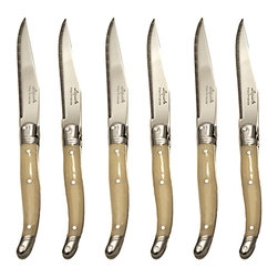 Set 6 Platine Steak Knives - White - Glossy paleness that contrasts just slightly with white dinnerware emphasizes the antique French-style curve of the Platine White Steak Knives' laguiole handles. Solid steel backbones and comfortable angles in both the handle and the blade make cutting on the plate an easy prospect, as do the sharp serrations of these top-quality steak knives, which are sold in sets of six.