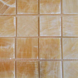 """Honey Polished Square Pattern Mesh-Mounted Onyx Tiles - 2"""" x 2"""" Honey Mesh-Mounted Square Pattern Onyx Mosaic Tile is a great way to enhance your decor with a traditional aesthetic touch. This polished mosaic tile is constructed from durable, impervious onyx material, comes in a smooth, unglazed finish and is suitable for installation on floors, walls and countertops in commercial and residential spaces such as bathrooms and kitchens."""