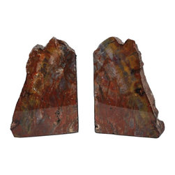 "Michal and Company - Arizona Conifer Petrified Wood Bookends - Dazzling! These Petrified Wood Bookends are impressive and full of unique color detail; accents in red, yellow, violet, brown, peach, white and green. The cut slabs are high-gloss coated on one side, and in natural finish on the other. Bottom and inside cut is lined with black felt. Perfect design item for the office or library. Ideal gift for the person who usually ""has everything."""