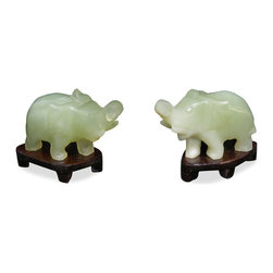 China Furniture and Arts - Hand Carved Jade Lucky Elephants - During the times of ancient China, elephants roamed many parts of the countryside, and their figure has been popular for centuries in Chinese households. Perceived as one of the most intelligent animals, the elephant has long been seen to symbolize wisdom and prosperity. Therefore the tradition of having objects on elephant in the home has continued over the ages. Color and sizes may vary slightly with each set. Please allow us to select for you. Wooden stands included.