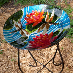 Alpine - Alpine Dragonfly and Flowers Glass Bird Bath with Stand - JAY104A-18 - Shop for Garden Bird Baths from Hayneedle.com! The Alpine Dragonfly and Flowers Glass Bird Bath with Stand is so beautiful and delicate-looking you may not want the birds to use it. This bird bath features a curvaceous four-legged steel stand that supports the glass bowl. The entire bowl is brightly colored and has a lovely dragonfly and flower image. The bowl is 3 inches deep and this birdbath stands 27 inches tall. Like stained glass for your garden!About Alpine CorporationAlpine Corporation is one of the world's leading manufacturers of fountains pond supplies and garden decor. They offer superior quality products including solar landscape lighting statuary and water fountains that eliminate the need for long wires and bulky cords. Recently Alpine Corporation won the coveted True Value Vendor of the Year Award.
