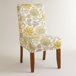 World Market - Tikki Yellow Anna Slipcover - Featuring a yellow and gray design with a textured feel, our exclusive slipcover offers a colorful style update to our Anna Slipcover Chair- an affordable way to get a brand new look. Mix and match it with our solid slipcovers to personalize your dining room.