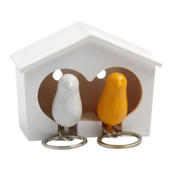 Sparrow Couple Key Holder - A little birdie told us these adorable birdhouses are just the right place to hold your keys! The Sparrow Couple Bird House Key Rings is a birdhouse shaped key holder and sparrow key rings. It holds two Sparrow Key Rings. The key rings also function as whistles. Sticky pads are included on the back of the birdhouse and you can also pop it on a nail.