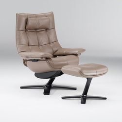 Natuzzi Re-Vive Suit - In updated classic styling, Re-Vive's new Club performance recliner features a smart stitching treatment that mimics the look of a button-tufted back. Available in an expanded range of five leathers with multiple color options and three new fabric groups, including a microfiber, a woven and a bouclé.