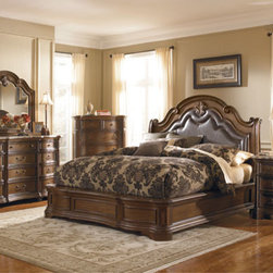 The Courtland - The Courtland collection has a stately traditional look with a contoured 100% leather headboard and nickel finished nail heads. The chest, dresser, nightstand and TV console have reversible felt-lined drawers that are finished inside and out as well as real marble tops on the nightstand and dresser. Photo: Pulaski Furniture