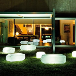 Serralunga - Meteor Illuminated Outdoor Planters by Serralunga - Meteor Illuminated Outdoor Planters by Serralunga. Meteor is the quintessential informal system of sitting for indoor and outdoor furniture. Arik Levy's rocks perfectly blend both in a natural landscape and in all interior. Available also in luminous and bench versions. Meteor Illuminated Outdoor Planters by Serralunga are designed by Arik Levy.