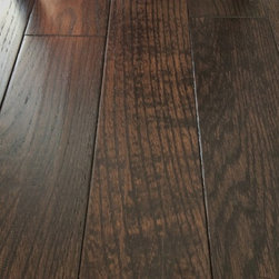 Handscraped & Distressed Floors - Handscraped distressed American Hickory solid wood flooring with five inch plank widths, a Charcoal stain, and an 11-coat UV-cured no-VOC prefinish from Eastern Star Wood Floors, sku# EGH5W123.