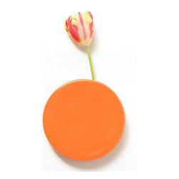 Orange Wall Dots Vase - This wall-mounted vase is so fun! It is like a big polka dot on the wall if it doesn't have flowers in it. This would go really well on a wall with mounted platters and clocks.