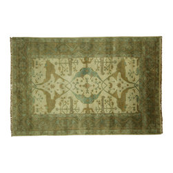 Manhattan Rugs - New Silver Washed Ivory & Green Oushak 6'x9' Hand Knotted Turkish Wool Rug H3552 - Heriz is situated in the northwestern part of Iran (Persia).  Though the term covers Hand knotted rugs of numerous small villages in the area, the most beautiful Rugs were woven in Heriz itself For the last 100 years, the Heriz carpet designs have basically remained the same, with only small variations in color pallets and density of the design. The late 19th Century Rug (so called Serapis) was of fewer details and softer colors and with time designs became denser with added jewel tone color pallets. The revival of the carpet industry in the late 19th Century was based on the demand of the Western markets, with America in particular.  Weavers in Heriz hand knotted were asked to make carpets inspired by the Fereghan Sarouks of higher cost for consumers of more limited budgets. Even though Sarouk carpets changed style later on, Heriz weavers stayed with the geometric pattern till now.  However, Heriz was also a center of production of some of the best handmade carpets with both geometric and curvilinear floral patterns.  A special heirloom wash produces the subtle color variations that give rugs their distinctive antique look.