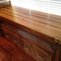 Plantation Teak Butcher Block and Edge Grain Countertop - Plantation Teak breakfast table with roll out seating.