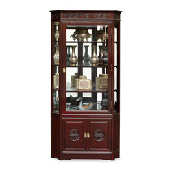 China Furniture and Arts - Rosewood Longevity Design Corner Cabinet - Made of solid rosewood, this corner curio cabinet will exhibit your treasured collectibles with the best effect. The half-hexagon shape allows viewers to see the artwork from three sides. Museum quality lighting and mirror bring out all the details. The longevity emblem is hand-carved on the two doors. With this cabinet in your home, cheerfulness is added to its surroundings. Hand applied rich cherry finish. Beveled glass.