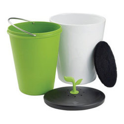 No-Odor Compost Bucket - See it, don't smell it, with this unique ceramic compost bucket. The plastic interior bucket is removable for easy cleaning, while the lid's odor-absorbing filter makes this a fun way to compost that will be seen and not smelt. The sprouting topper adds organic charm to your kitchen, while stopping odor in its tracks.