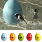 Egg Birdhouse - The simple glossy Easter egg is so fun as a bird feeder. I wish I had a tree in my yard for such a cute house.