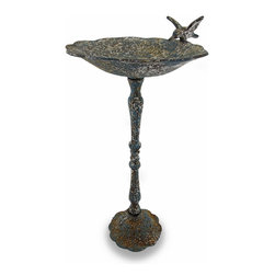 Zeckos - Distressed Finish Cast Iron Bird Feeder Sculpture - Have your own bevy of birds in your yard or garden with this classic styled Victorian inspired bird feeder Made from cast iron, it stands 23 inches (58 cm) high on a 6 inch (15 cm) diameter base with a generous 10 inch (25 cm) diameter bowl featuring a hummingbird accent on the lip. This bird feeder will look right at home in your garden oasis with its highly distressed, time-worn verdigris finish that will add a lovely vintage accent inside your home, too Wherever you choose to display this cast iron bird feeder sculpture, it's sure to be admired