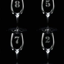 "Crystal Imagery, Inc. - Numbered Wine Glasses, 1 - 8 Engraved - Engraved Numbered 1 thru 8 Wine Glass Set are a great way to keep track of your own drink at the party! These numbered wine glasses come in a set of 8, each featuring their own number boldly carved into the wine glass surface. These glasses are a great housewarming, wedding, anniversary or holiday gift idea. Deeply carved using our sand carving technique, each wine glass is meticulously custom made to order making it the perfect gift for those seeking unique gift ideas for wine lovers - men and women alike. At 9"" high by 3.5"" wide, our wine glasses hold 19 oz. A set of these etched wine glasses will be the favorite gift at any special gift giving occasion. Dishwasher safe."