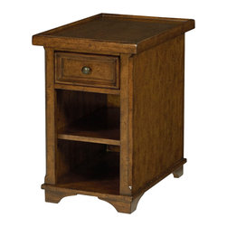 Hammary - Hammary Homestead Chairside Table in Antique Brown - Each-piece is outfitted with metal accents, either in the form of a metal base, or as a metal grill placed under lightly seeded glass in the tops. Traditional legs are turned round and can be seen throughout the group. The console table, round end table, and entertainment console each have birch veneer tops. A bygone medium brown finish is applied to the birch solids and veneers, achieving a comfortable blend of styles. The metal on all of the pieces has an antique brass finish that matches the metal knob hardware found throughout the group on the doors and drawers.