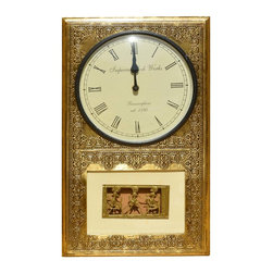 "Sierra Living Concepts - Brass & Mango Wood Traditional Wall Clock - Make the most of every minute with our art quality 17"" by 14"" Wall Clock. The ornate brass inlaid frame is hand crafted from solid mango wood, a tropical eco-friendly hardwood that is grown as a renewable crop. The round black and white clock face has two hands and classic roman numerals. In the bottom of the clock frame three brass wire-like characters are frozen in time. The decorative pattern is repeated on the top and bottom."
