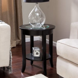 Eaton End Table - The Eaton End Table makes a bold accent to your contemporary style living room or den. Its handsome frame is made from solid wood and features a cantered lower display shelf and a rich brown espresso finish. Its round shape is complemented by the beveled clear glass inset in the pieces top. This sleek contemporary style piece makes a handsome complement to your leather furniture or modern style design. Some assembly required.