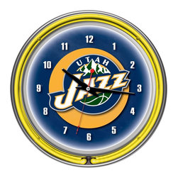 Trademark Global - Utah Jazz NBA Chrome Double Ring Neon Clock - High Grade Glass Cover. High Polished Chrome Finish Molded Resin Housing. Officially Licensed Full Color Logo on the Clock Dial. Double Ringed Neon (Outside Ring Coordinates with Printed Logo and Inside Ring Illuminates the Clock Face). Battery Operated Quartz Clock Mechanism. Requires 1 AA Battery for Clock Operation (Not Included). AC Power Adapter with 6 ft. Cord . Wall Hanging Mount. Dimensions: 3 x 14.5 x 14.5 inchesEvery game room, garage or man cave could use the addition of an officially licensed neon clock. So why not add one of the highest grade clocks on the market to your collection? This impressive clock has not just one but two neon rings. It has an accent colored neon ring on the exterior and a brilliant white neon ring on the interior of the clock to light up your favorite logo. Other highlights include chrome finished resin housing and a high grade glass clock face cover. The battery operated quartz clock mechanism will keep your new prize precise and ticking for a long time, while the neon runs off the included AC adapter. The neon is controlled by the pull chain and the back of the clock includes a wall hanging mount. The 3 inch depth of this clock combined with the radiant shimmer of the neon reflecting off the chrome housing is sure to make this clock pop off of any wall. Bring style and function to your game room,garage or collection with an officially licensed double ringed neon clock.