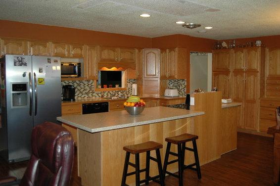 Burnt Orange Walls with Honey Oak Kitchen Cabinets