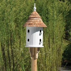 Lazy Hill Farms Bird House - A garden show-stopper, the Lazy Hill Farms Bird House has the look of a classic English dovecote yet made durable enough to withstand all elements. This detailed bird house is crafted of solid cellular vinyl, which is a wood alternative that looks and feels like genuine wood yet requires no maintenance. It has a redwood shingle roof that removes for easy cleaning and comes complete with a metal plate for post mounting. Eight separate compartments with perches give your feathered friends a cozy spot for their little families.About Lazy Hill Farm Designs Lazy Hill Farm Designs is a leader in garden and birding accessories. They are known for turning exquisite designs into exceptional quality garden accessories. All Lazy Hill Farm products are made of solid cellular vinyl that looks and feels like genuine wood yet requires no maintenance. All the roofs are removable for easy cleaning and each one is handcrafted in America. These are among the finest garden accessories on the market.