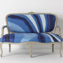 "Louisa Settee - I can almost make up the story behind this settee. Vera Nauman finds it in a Parisian flea market with the stuffing and springs coming out of it. She ships it back to the states, rips up a bunch of old Levi's, stiches them on in waves, and wahlah, this settee star is born. Eight-way hand-tied seat construction Cotton, linen upholstery Kiln-dried hardwood frame; poly dacron fill 38.5""H, 59""W, 42""D Seat: 16""H Handcrafted in USA $2498.00"