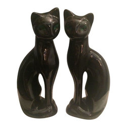 Pre-owned Mid-Century Black Siamese Cat Statuettes - A Pair - A pair of Mid-Century ceramic green eyed cat figures with original green felt bottoms. The pieces are stamped, Made in Taiwan. This sleek glossy black duo will add edge to any space!