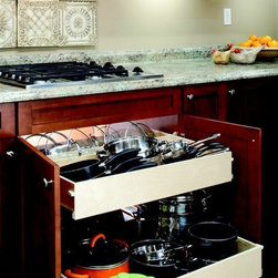 Pull Out Shelves for Your Pots and Pans - Store your pots and pans where they're easily accessible, on a pull out shelf from ShelfGenie.  The top pull out shelf features a lid rack in the back so the lids can be stored upright - easy to grad and easy to put away.