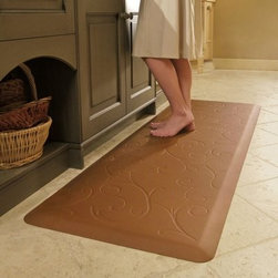 Wellness Mats Motif MB32WMR Bella Anti Fatigue Mat - For comfort wherever you stand, try the Wellness Mats Motif MB32WMR Bella Anti Fatigue Mat. Featuring a subtle scroll design, this door mat brings form and function to your home. The polyurethane anti-fatigue mat is ergonomically engineered and medically proven to provide comfort and support while you stand. The door mat is designed to last, as it is puncture- and heat-resistant, and the edges will never curl. It also has a no-trip beveled edge. Plus, the anti-microbial mat is easy to wipe clean. Available in your choice of color. Dimensions: 36L x 24W x 0.75H inches.