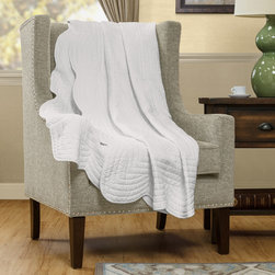 Madison Park - Madison Park Tuscany Quilted Throw - Tuscany is the perfect quilted throw for a new solid look. The decorative stitch pattern pairs easily with your existing d̩cor and will sure to add a new decorative element with the beautiful scalloped edges. This quilted throw is filled with cotton filling and features a polyester microfiber fabrication on the face and the reverse. Its prewash finish gives a worn in appearance to this decorative throw. Face and Reverse: 100% polyester micro fiber quilted, prewash finish Filling: cotton 200gsm