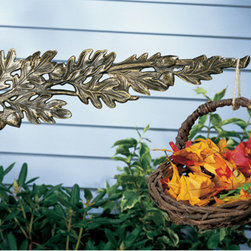 Oak Leaf Nature Hook - The elaborate details of the Oak Leaf Nature Hook will add a unique touch to your home or garden. Display plants, chimes or birdhouses with this useful and attractive piece.