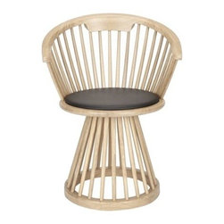 Tom Dixon - Tom Dixon | Fan Dining Chair - Design by Tom Dixon, 2013. An extension of Tom Dixon's highly regarded Fan Chair, the Fan Dining Chair is a dramatic companion to dining tables from simple to spectacular. This sculptural take on the traditional British Windsor Chair is adapted, in this version, to a dining side with a fanned spindle back and base. The birch or oak wood machined construction features a unique circular footing, adding to its sculptural depth. Available in Black Birch or Natural Oak with black leather seat pad.