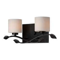 Quoizel - Quoizel ERN8602IB Erin Transitional Wall Sconce - The relaxed styling of this piece has a bit of whimsy with its swirled vine and leaf motif.  The wrought iron and opal etched glass add to the overall feel of its hip, coffeehouse style.