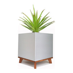 "NMN Designs - Madeira Cube Planter With Maple Base - The cube has been around since the beginning of time, but this sleek version looks as modern as ever. Constructed of high-grade aluminum with 16"" sides, the Madeira Cube is the perfect contemporary planter for showing off medium to large plants. The optional wood base raises the Madeira off the floor and takes this planter from stellar to stunning. Other details: heavy-duty build using seamless joint technology, and heat and fire resistant up to 500 degrees."