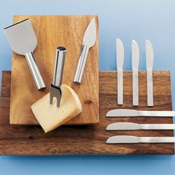 cheese cutters set of three - slinky cheese. An unconventional collection for those who know manchego isn't a Spanish dance. Tubular handles narrow into a slim, stainless slicer, fork and knife. Strong, sleek and modern, to turn even the hardest ripened into easy cheese.- Stainless steel- Dishwasher-safe- Made in China