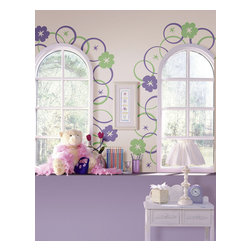"Hooplah Room Set of Wall Decals - Create a darling floral design on your walls complete with concentric circles and stars, with the Hooplah Room Set. These lavender and mint green wall decals are both adorable and cheerful. Hooplah circles contain 5 pieces printed on a 13"" x 13"" sheet and come 4 sheets to a pack. The Hooplah Room Set includes 1 pack of Green and 1 pack of Purple Circles for a total of 40 pieces."