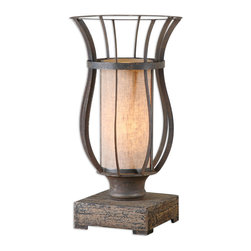 Uttermost - Minozzo Bronze Accent Lamp - Imagine this lamp or a pair of them, sitting on your sideboard in your dining room. The rustic bronze metal cage surrounds a linen inner shade in the shape of pillar candle. The glow from this lovely lamp will add ambience to your next romantic dinner.