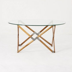 Truss Coffee Table - I think I normally stay away from glass top tables, but this one has an edginess to it that I think will pair well with a classic couch like a Chesterfield.