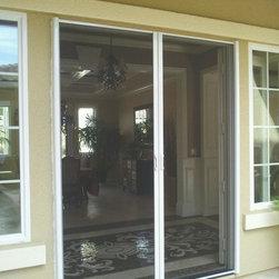 Mirage Retractable screen door - oscar lopez