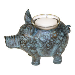 Sterling Industries - Sterling Little Pig Votive Candle Holder - One of the most beloved farm animals is the pig. A highly intelligent and adorable creature, decorative pig accessories have become highly collectible. The little pig votive candle holder by Sterling will surely become a collector's favorite bringing accent light and a touch of whimsy to the decor. The pig votive will add a decorative accent on the table and will illuminate a special place in the home with warm, flickering candlelight. Painted in a mottled green and black that resembles a patina effect on aged copper. Pig is 6.5 inches long and 3 inches wide and 4 inches tall.